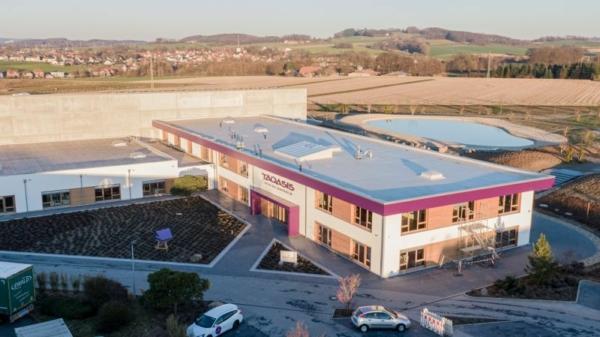 Taosis investiert in einen nachhaltigen Neubau.